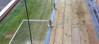 Large frameless glass balustrade for external decking area. Supplied and Fitted.